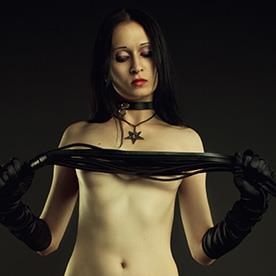 Woman with a whip seek man