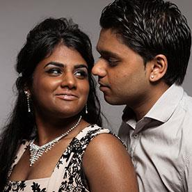 Indian couple smiling, embracing,