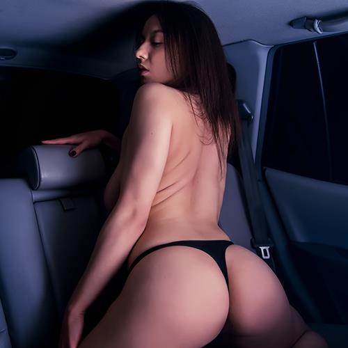 woman legs spread in thong on the back seat of a car