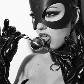 BDSM, woman licking ball gag